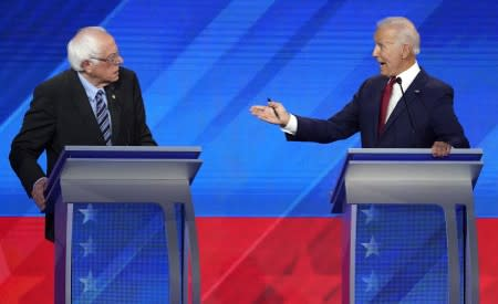 Former Vice President Biden speaks to Senator Sanders during the 2020 Democratic U.S. presidential debate in Houston, Texas, U.S.