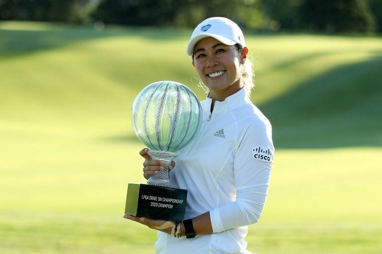 American Danielle Kang holds the trophy after winning the LPGA Drive On Championship on Sunday in the tour's first event since February due to a COVID-19 hiatus