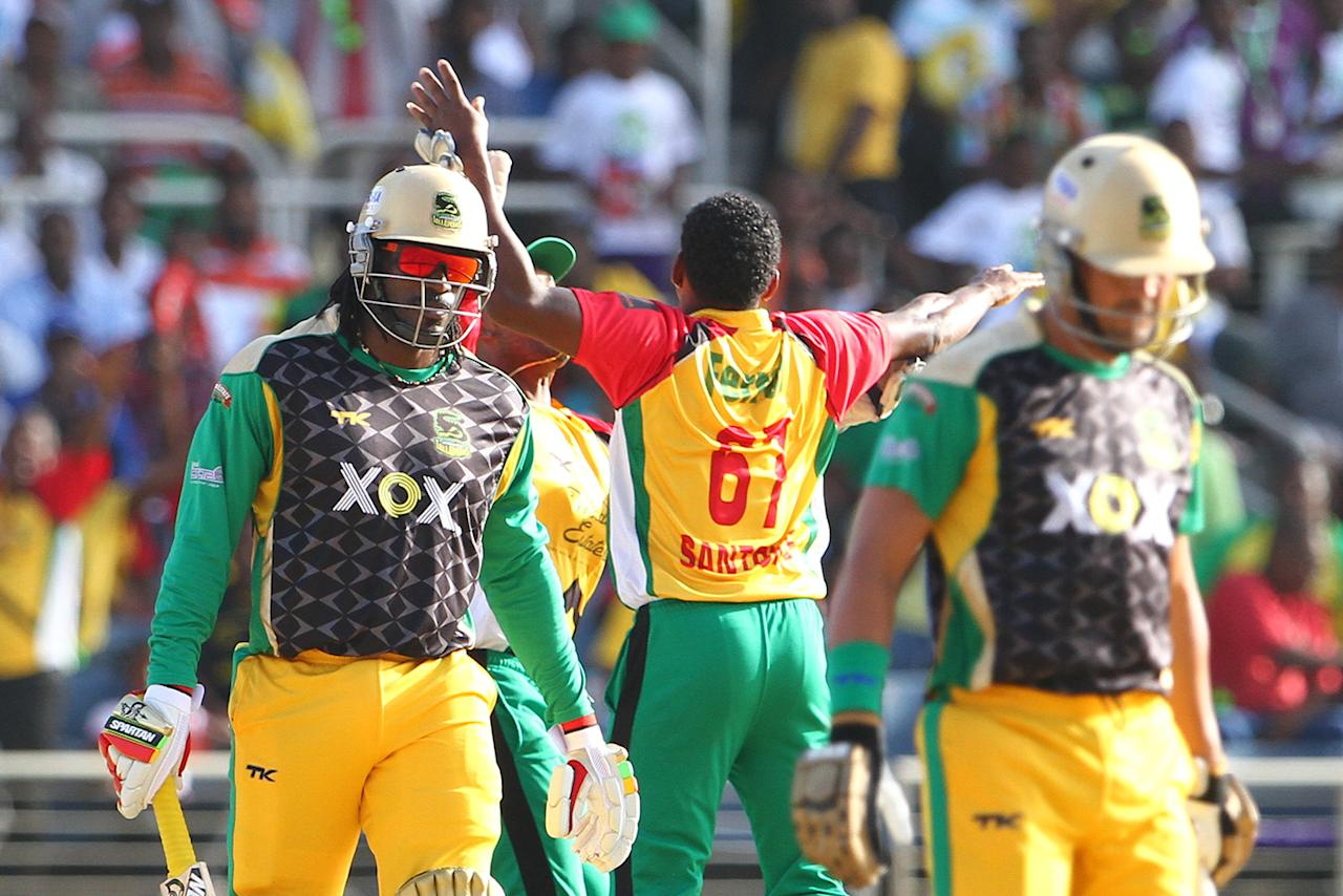KINGSTON, JAMAICA - AUGUST 15: Guyana Amazon Warriors Krishmar Santokie gets the wicket of Chris Gayle during the Sixteenth Match of the Cricket Caribbean Premier League between Jamaica Tallawahs v Guyana Amazon Warriors at Sabina Park on August 15, 2013 in Kingston, Jamaica. (Photo by Ashley Allen/Getty Images Latin America for CPL)