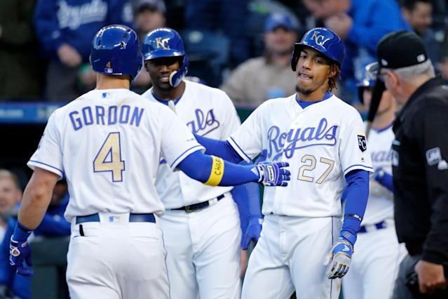 "Royals' sports Alex Gordon celebrates his home run and shows support for ""Charlie."" (AP Photo)"