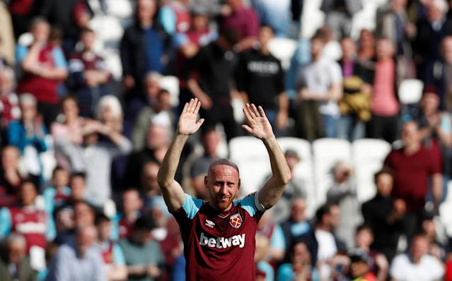 "Soccer Football - Premier League - West Ham United vs Everton - London Stadium, London, Britain - May 13, 2018 West Ham United's James Collins gestures to fans after the match Action Images via Reuters/Paul Childs EDITORIAL USE ONLY. No use with unauthorized audio, video, data, fixture lists, club/league logos or ""live"" services. Online in-match use limited to 75 images, no video emulation. No use in betting, games or single club/league/player publications. Please contact your account representative for further details."