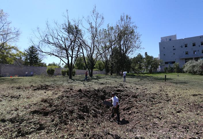 A hole is seen inthe backyard of the Grand National Assembly.