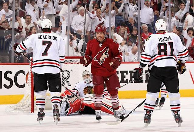 GLENDALE, AZ - APRIL 14: Raffi Torres #37 of the Phoenix Coyotes reacts after Antoine Vermette (not pitctured) scored a second period power play goal past goaltender Corey Crawford #50 of the Chicago Blackhawks in Game Two of the Western Conference Quarterfinals during the 2012 NHL Stanley Cup Playoffs at Jobing.com Arena on April 14, 2012 in Glendale, Arizona. (Photo by Christian Petersen/Getty Images)