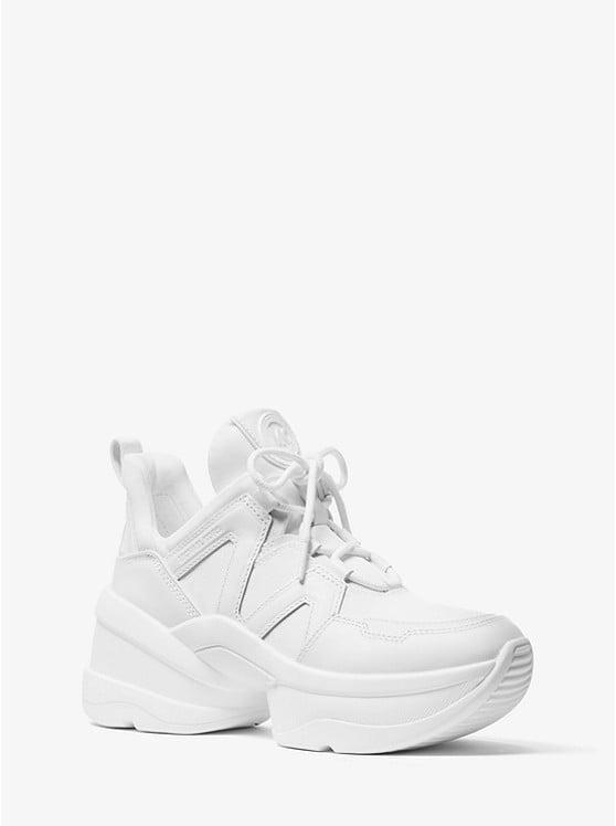 <p>Instead of your classic white kicks, opt for these <span>Michael Kors Olympia Canvas and Leather Trainers</span> ($170).</p>
