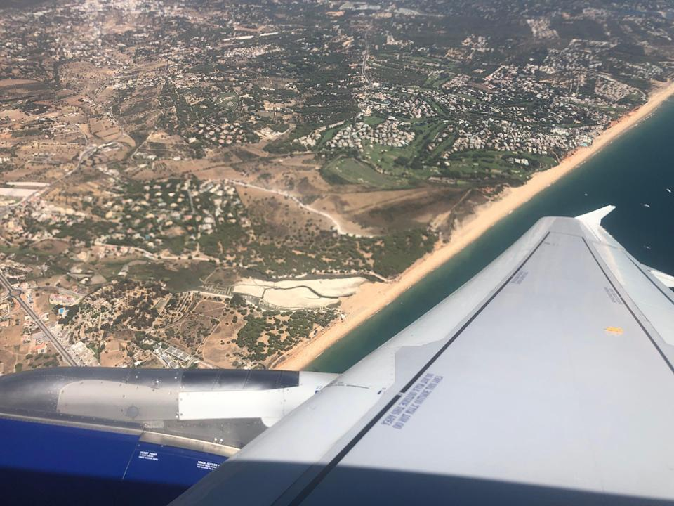 Landing soon: a British Airways Airbus A320 approaching Faro on the south coast of Portugal (Simon Calder)