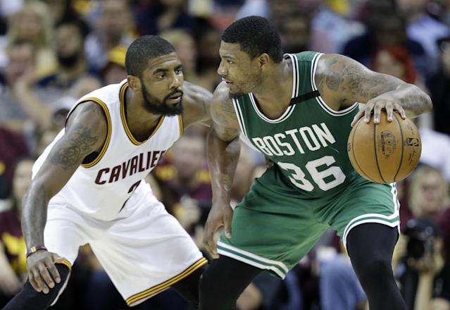 Marcus Smart works against Kyrie Irving in Game 3 on Sunday night. (AP)
