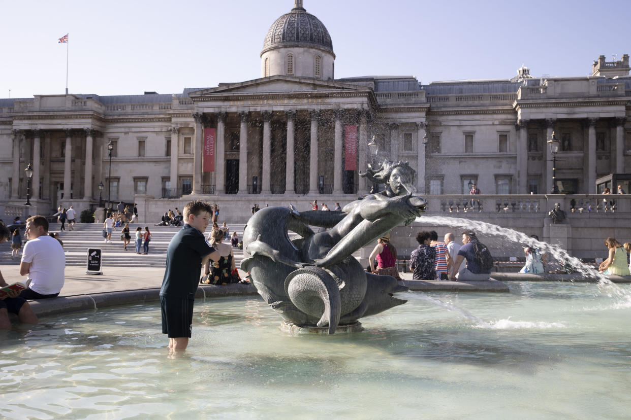 A young boy is seen playing in the fountain at Trafalgar Square ahead of a mini heatwave set to hit UK over the weekend followed by a fierce storm. The temperature will go above 30 degrees celsius on Sunday bringing on the hottest day of the year so far. (Photo by Hesther Ng / SOPA Images/Sipa USA)