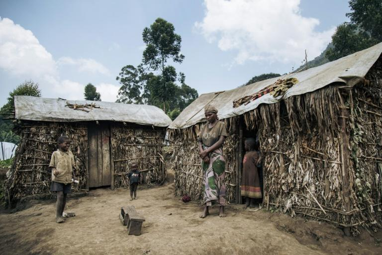 Away from the Ebola headlines, tens of thousands of people are scattered in squalid camps across the mountains around Masisi (AFP Photo/ALEXIS HUGUET)