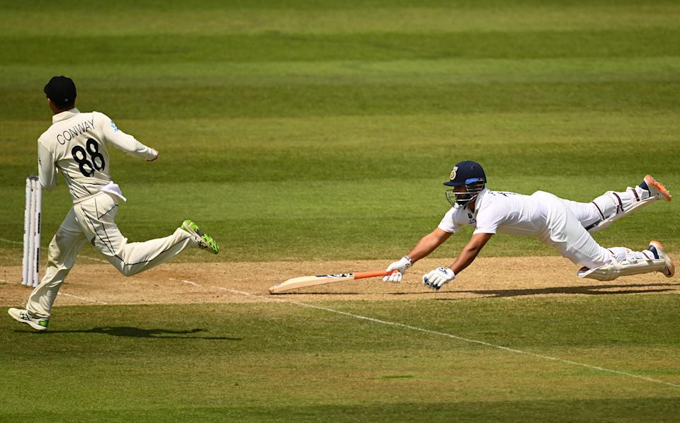 SOUTHAMPTON, ENGLAND - JUNE 23: Rishabh Pant of India survives a run out attempt from Devon Conway of New Zealand during the Reserve Day of the ICC World Test Championship Final between India and New Zealand at The Hampshire Bowl on June 23, 2021 in Southampton, England. (Photo by Alex Davidson/Getty Images)