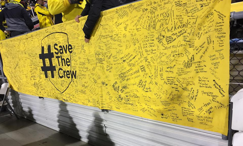 Columbus Crew fans signed a banner at a rally at City Hall on Sunday, Oct. 22. The banner was displayed at the NYCFC game. (Henry Bushnell/Yahoo Sports)