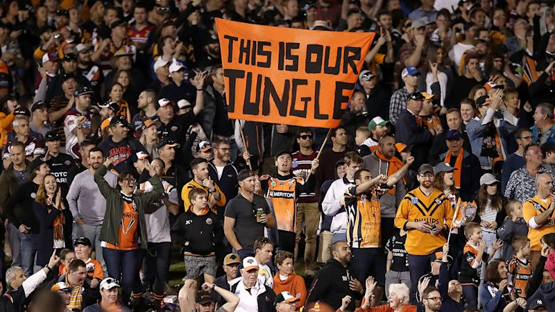 Pictured here, Wests Tigers fans cheer on a match at Leichhardt Oval.