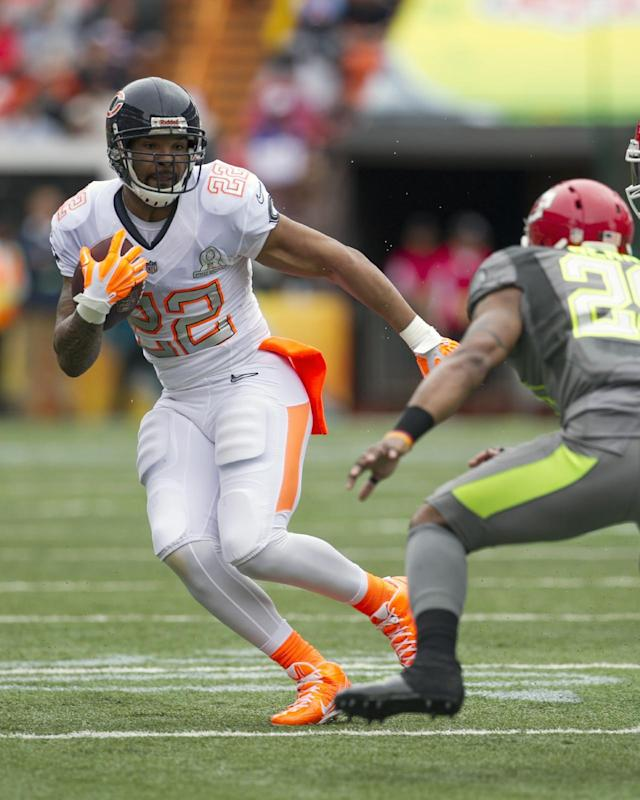 Kansas City Chiefs wide receiver Dexter McCluster (22). of Team Rice. tries to get past Kansas City Chiefs safety Eric Berry (29). of Team Sanders. during the first quarter at the NFL Pro Bowl football game at Aloha Stadium, Sunday. Jan. 26, 2014, in Honolulu. (AP Photo/Marco Garcia)