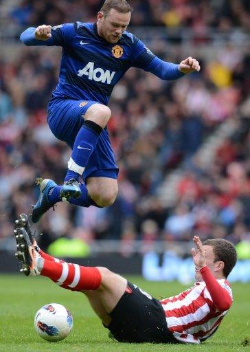 Manchester United striker Wayne Rooney (left) vies with Sunderland midfielder Craig Gardner (right) in a match in Sunderland in May. Manchester United, overloaded with debt since their takeover by a billionaire American family of investors, is moving to raise cash through a US share sale