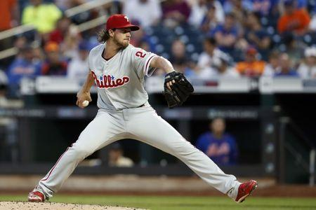 Jul 9, 2018; New York City, NY, USA; Philadelphia Phillies starting pitcher Aaron Nola (27) pitches against the New York Mets during the first inning at Citi Field. Mandatory Credit: Adam Hunger-USA TODAY Sports