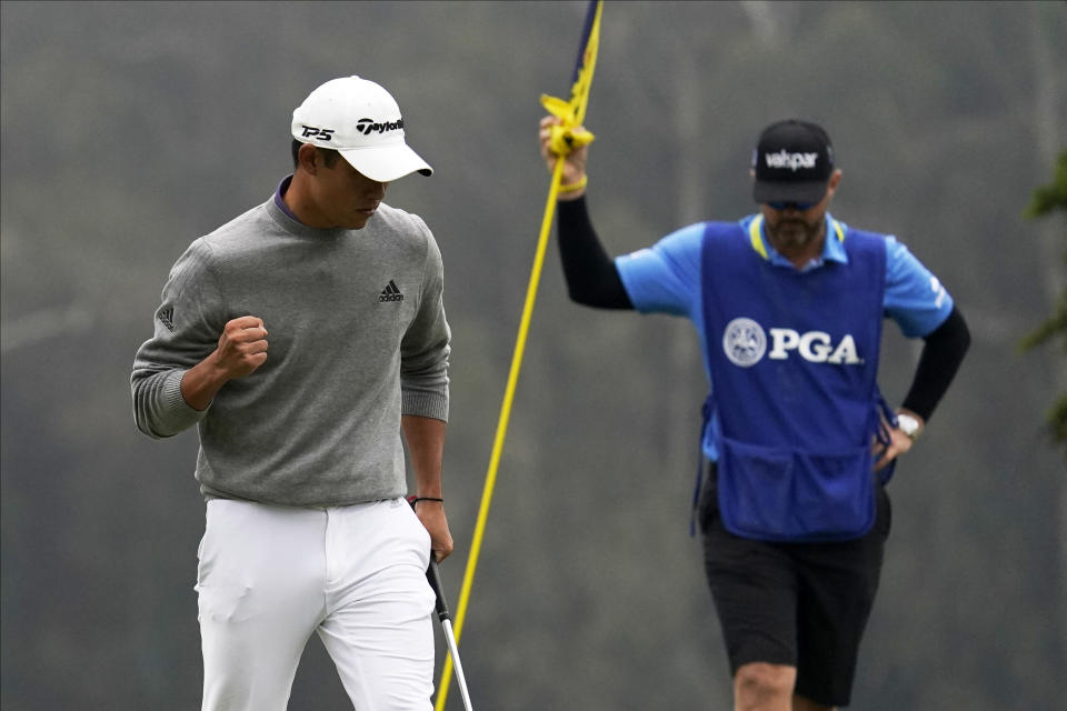 Collin Morikawa celebrates after a birdie on the 16th hole during the final round of the PGA Championship golf tournament at TPC Harding Park Sunday, Aug. 9, 2020, in San Francisco. (AP Photo/Jeff Chiu)