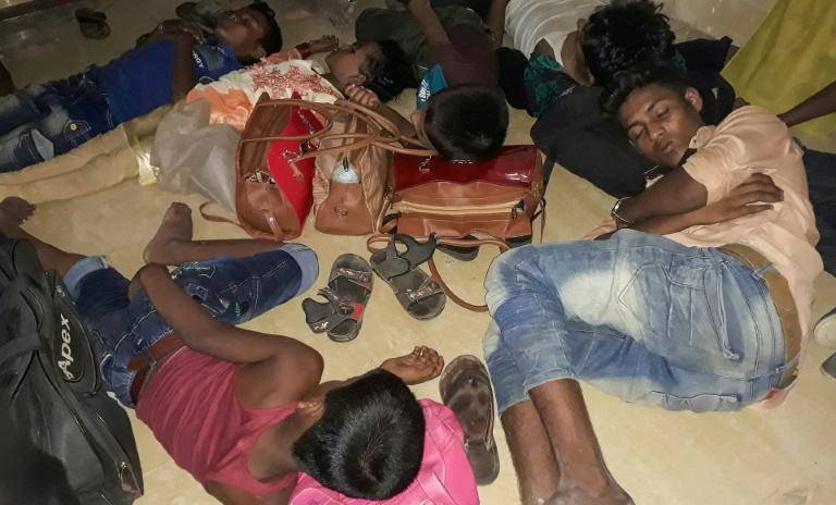 Young Rohingya refugees sleep in a police station in Cox's Bazar, Bangladesh, in May 2019, after police said they were rescued from human traffickers