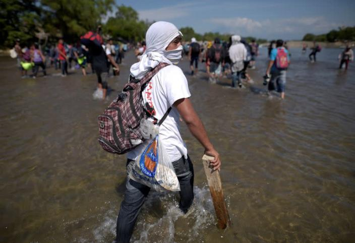 Migrants, part of a caravan travelling to the U.S., cross the Suchiate river from Tecun Uman, in Guatemala, to Ciudad Hidalgo