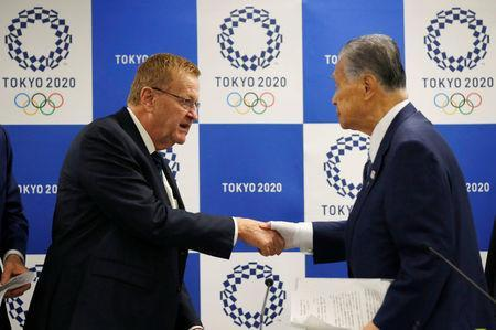 International Olympic Committee (IOC) Vice President John Coates (L) shakes hands with President of Tokyo 2020 Olympic and Paralympic organising committee Yoshiro Mori after their news conference following Project Review Meeting in Tokyo, Japan, April 24, 2018. REUTERS/Toru Hanai