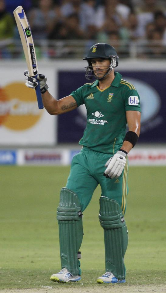 South Africa's Faf du Plessis celebrates his half century during their second Twenty20 international cricket match against Pakistan in Dubai November 15, 2013. REUTERS/Nikhil Monteiro (UNITED ARAB EMIRATES - Tags: SPORT CRICKET)