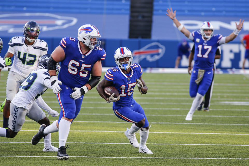 iBuffalo Bills' John Brown (15) runs after making a catch as quarterback Josh Allen (17) reacts during the second half of an NFL football game against the Seattle Seahawks, Sunday, Nov. 8, 2020, in Orchard Park, N.Y. (AP Photo/Jeffrey T. Barnes)