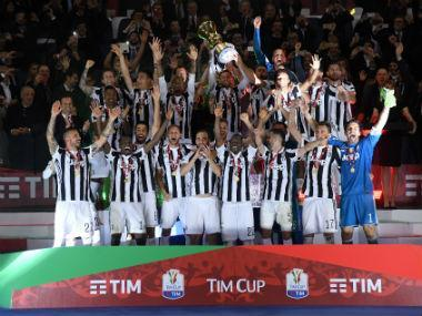 Juventus ran riot to beat blundering AC Milan 4-0 on Wednesday in Rome's Stadio Olimpico and lift the Italian Cup for a fourth consecutive year.