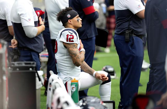 Houston wide receiver Kenny Stills kneels during the national anthem before a September game in 2019. (Kevin Jairaj/USA TODAY Sports)