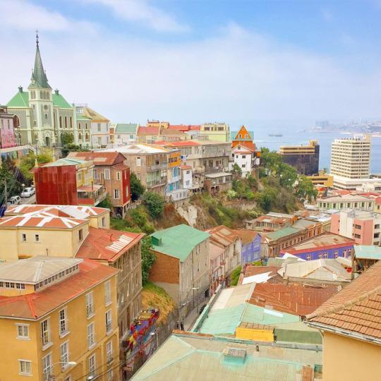 "<p>I stumbled upon this stunning hilltop view of Valparaiso — Chile's vibrant bohemian port city — while weaving through a labyrinth of steep streets and alleys during an urban art tour. World-renowned graffiti artists and muralists have transformed ""Valpo"" into an open-air gallery full of colorful surprises. <i>—Nora Walsh, <a href=""http://patchworkcompass.com/"" rel=""nofollow noopener"" target=""_blank"" data-ylk=""slk:Patchwork Compass"" class=""link rapid-noclick-resp"">Patchwork Compass</a></i><br></p>"