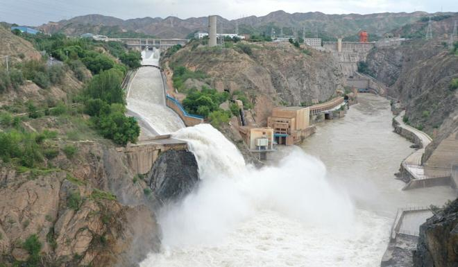 Water gushes from sluiceways of the Liujia Gorge reservoir in Gansu province on Friday. Photo: Xinhua