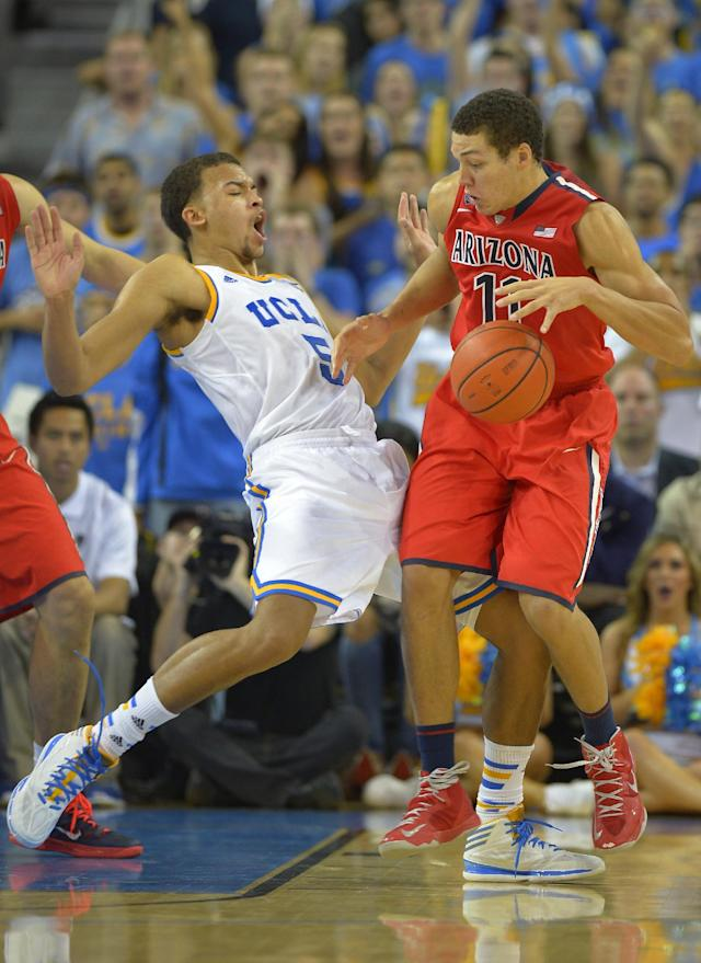 Arizona forward Aaron Gordon, right, collides with UCLA forward Kyle Anderson during the second half of an NCAA college basketball game on Thursday, Jan. 9, 2014, in Los Angeles. (AP Photo/Mark J. Terrill)