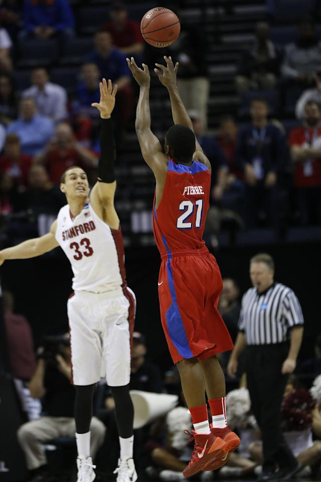 Dayton forward Dyshawn Pierre (21) shoots against Stanford forward Dwight Powell (33) during the first half in a regional semifinal game at the NCAA college basketball tournament, Thursday, March 27, 2014, in Memphis, Tenn. (AP Photo/John Bazemore)