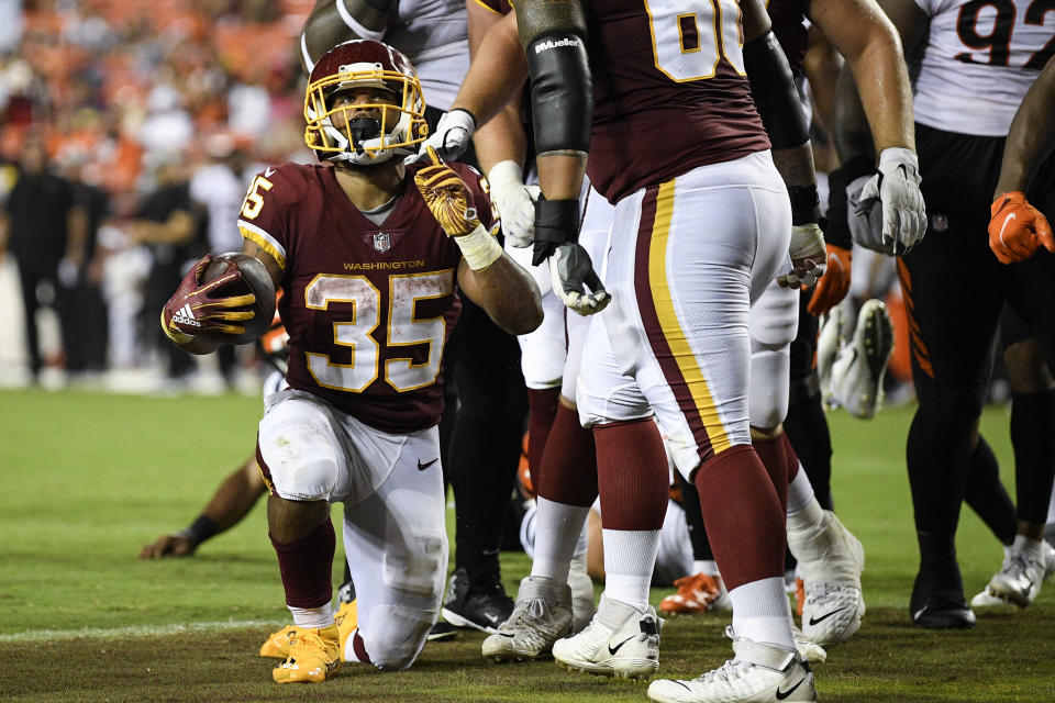 Washington Football Team running back Jaret Patterson (35) celebrates his touchdown during the second half of a preseason NFL football game against the Cincinnati Bengals, Friday, Aug. 20, 2021, in Landover, Md. (AP Photo/Nick Wass)