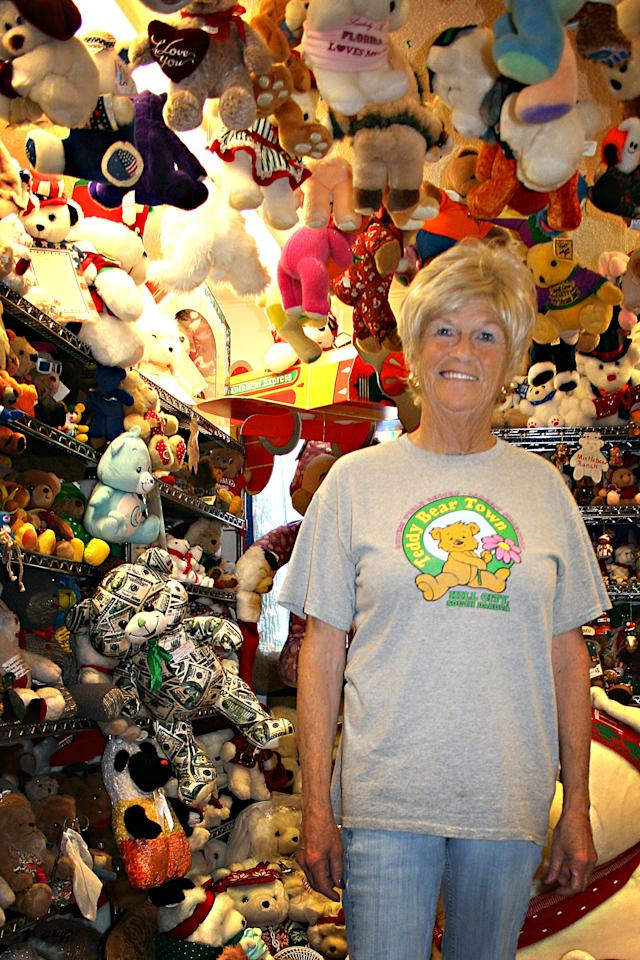 Jackie Miley, 63, is surrounded by teddy bears in this July 21, 2012, photo at Teddy Bear Town in Hill City, S.D. With 7,790 teddy bears in her collection, Miley holds the Guinness World Record for largest teddy bear collection. (AP Photo/Kristi Eaton)