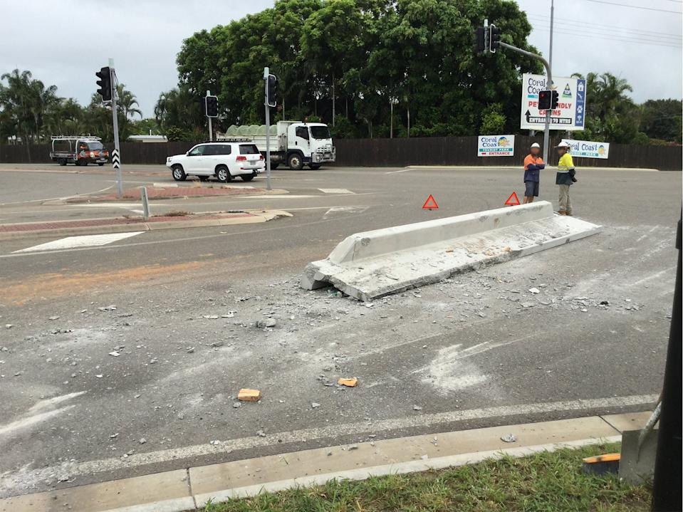 A concrete barrier sits on the road after falling off a truck in Townsville.