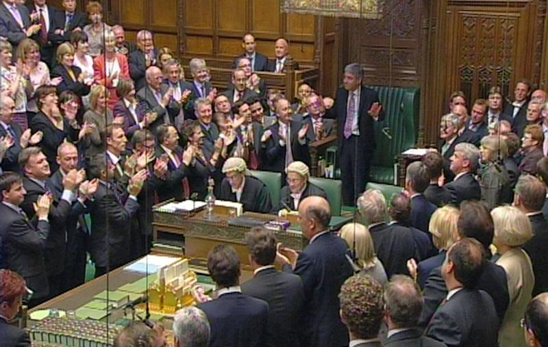 John Bercow MP, standing, hands raised, addresses the House of Commons in this image made from TV, in London, Monday, June 22 2009. Members of Britain's House of Commons elected John Bercow, a member of the main opposition Conservative party, as their new speaker on Monday after the previous holder was forced out amid an expenses scandal. (AP Photo / House Of Commons TV via PA) ** UNITED KINGDOM OUT NO SALES NO ARCHIVE **