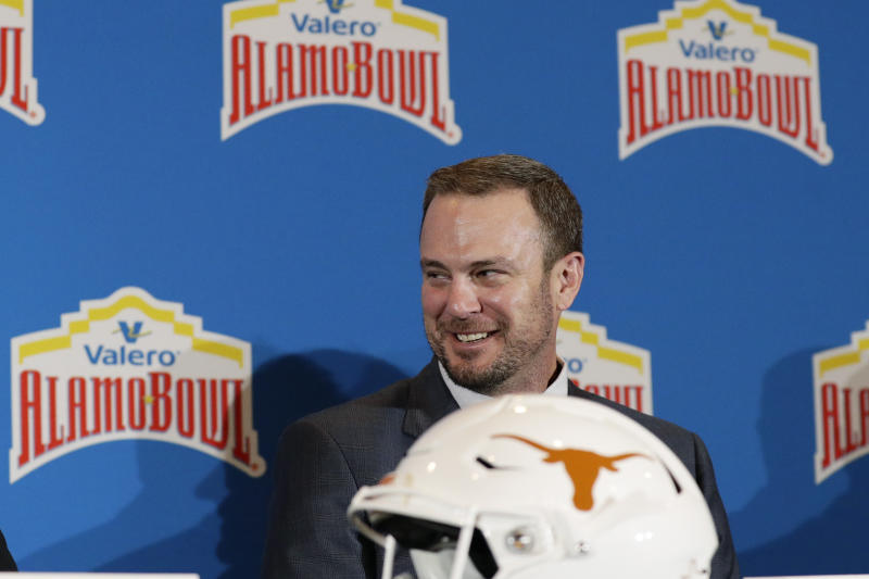 Texas head coach Tom Herman takes part in a news conference for the Alamo Bowl NCAA college football game, Thursday, Dec. 12, 2019, in San Antonio. Texas will face Utah in the Alamo Bowl. (AP Photo/Eric Gay)