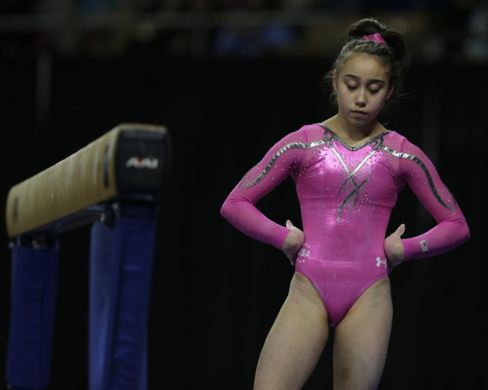 Katelyn Ohashi, of the United States, during the American Cup gymnastics competition in Worcester, Mass., Saturday, March 2, 2013. (AP Photo/Charles Krupa)