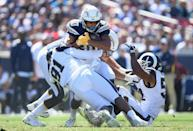 <p>Austin Ekeler #30 of the Los Angeles Chargers gets tackled by Dominique Easley #91 and Ramik Wilson #52 during the game at Los Angeles Memorial Coliseum on September 23, 2018 in Los Angeles, California. (Photo by Harry How/Getty Images) </p>