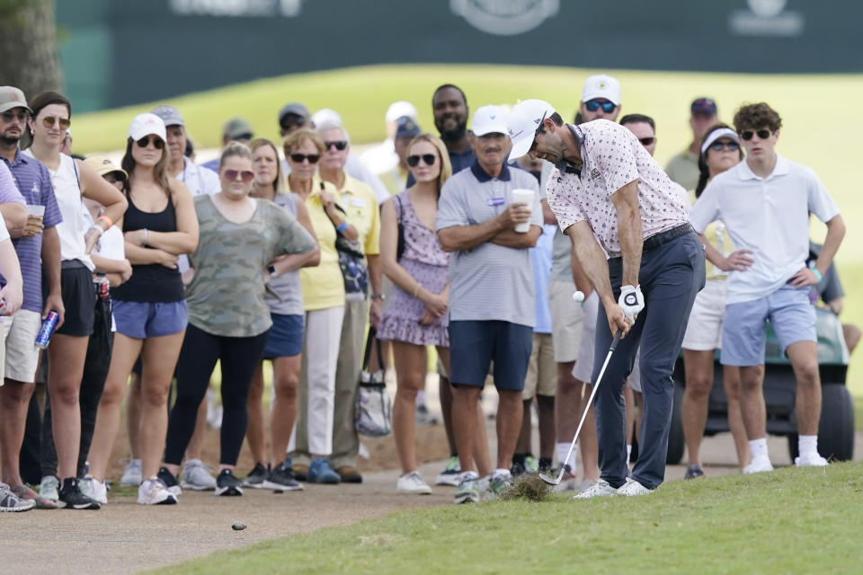 Spectators watch as Cameron Tringale hits after going out of bounds off the first fairway during the final round of the Sanderson Farms Championship golf tournament in Jackson, Miss., Sunday, Oct. 3, 2021. (AP Photo/Rogelio V. Solis)