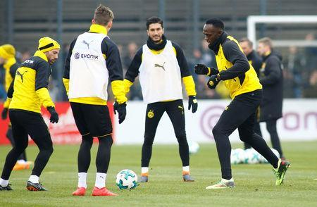 Soccer Football - Usain Bolt participates in a training session with Borussia Dortmund - Strobelallee Training Centre, Dortmund, Germany - March 23, 2018 Borussia Dortmund's Nuri Sahin and Usain Bolt during training REUTERS/Thilo Schmuelgen