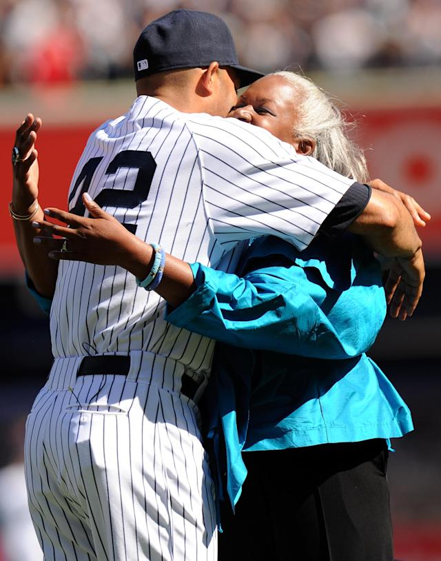NEW YORK, NY - SEPTEMBER 22: Mariano Rivera #42 of the New York Yankees hugs Sharon Robinson, the daughter of Jackie Robinson, during the Mariano RIvera Day pregame ceremony on September 22, 2013 at Yankee Stadium in the Bronx borough of New York City. (Photo by Maddie Meyer/Getty Images)