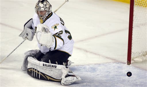 Dallas Stars goalie Kari Lehtonen, from Finland, lets in a goal during the first period of an NHL hockey game against the Calgary Flames in Calgary, Alberta, Monday, March 26, 2012. (AP Photo/The Canadian Press, Jeff McIntosh)