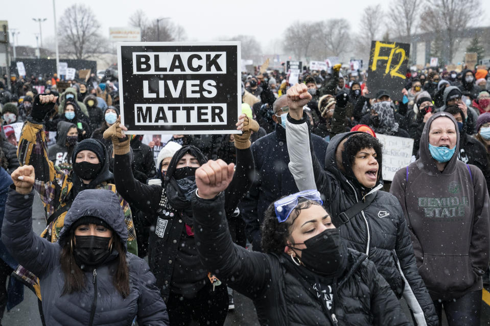 Demonstrators march to Brooklyn Center Police Department to protest the fatal shooting of Daunte Wright during a traffic stop, Tuesday, April 13, 2021, in Brooklyn Center, Minn. (AP Photo/John Minchillo)
