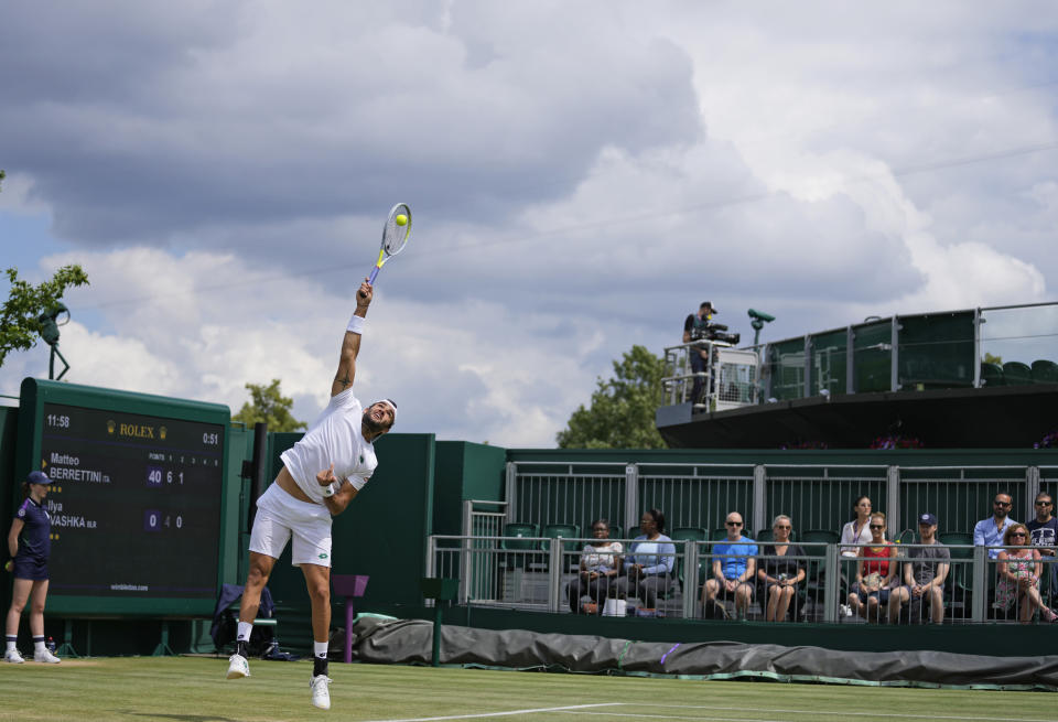 Italy's Matteo Berrettini serves to Ilya Ivashka of Belarus during the men's singles fourth round match on day seven of the Wimbledon Tennis Championships in London, Monday, July 5, 2021. (AP Photo/Kirsty Wigglesworth)