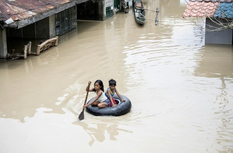 In a world that heats two degrees above preindustrial levels, land currently inhabited by 700 million people would regularly be inundated by high tides (AFP/NOEL CELIS)