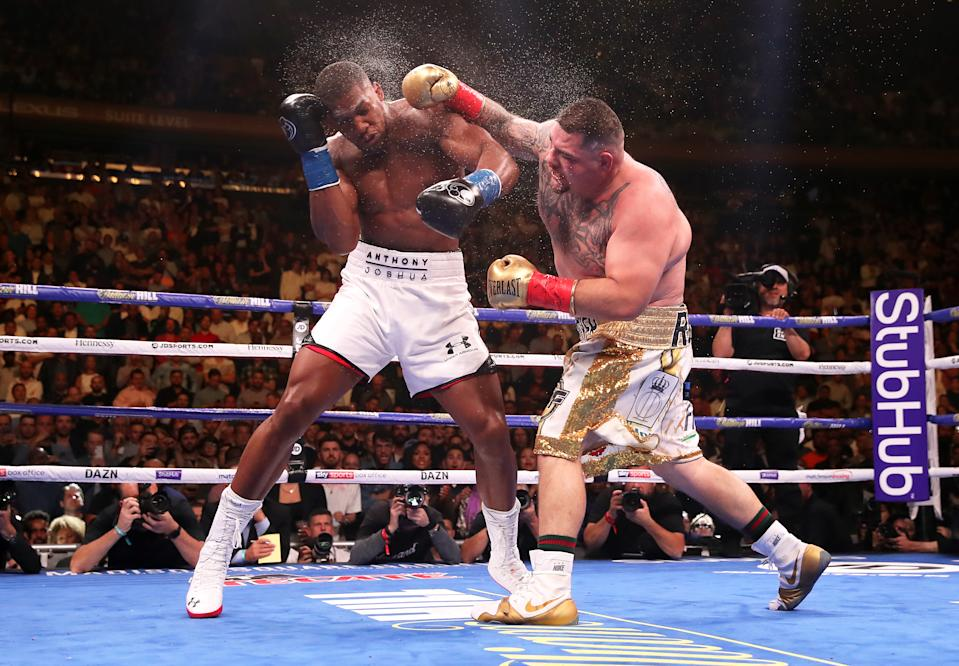 Anthony Joshua (left) in action against Andy Ruiz Jr in the WBA, IBF, WBO and IBO Heavyweight World Championships title fight at Madison Square Garden, New York. (Photo by Nick Potts/PA Images via Getty Images)