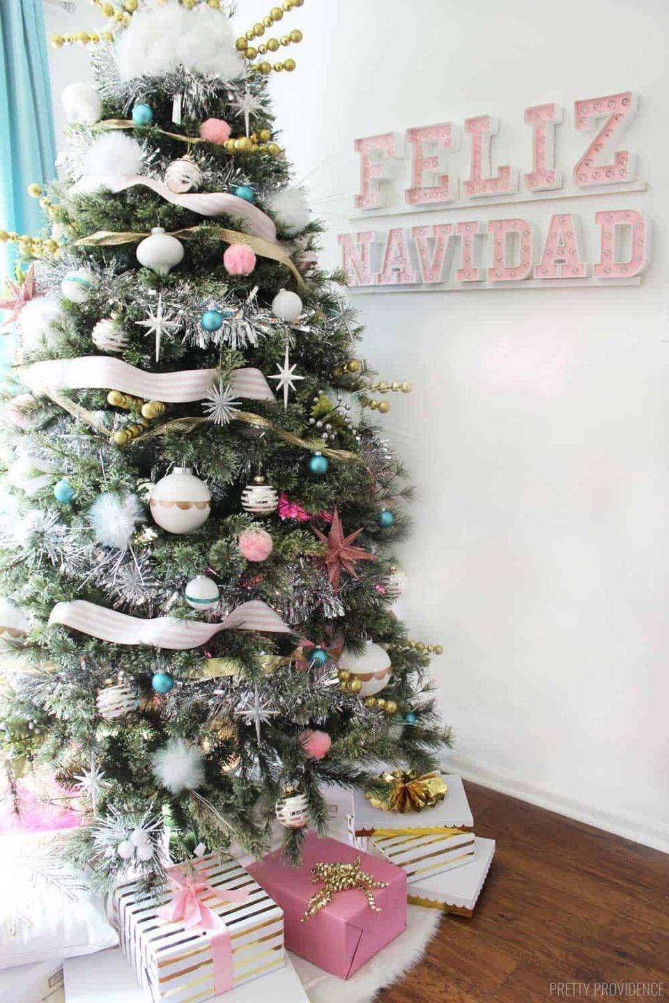 """<p>Haven't you heard? Pastels are in — at least with this tree they are. Light pink, baby blue, and white shatterproof ornaments make this tree toddler-proof and beautiful. </p><p><strong><em>Get the tutorial at <a href=""""https://prettyprovidence.com/mid-century-modern-christmas-tree/"""" rel=""""nofollow noopener"""" target=""""_blank"""" data-ylk=""""slk:Pretty Providence"""" class=""""link rapid-noclick-resp"""">Pretty Providence</a>.</em></strong></p><p><a class=""""link rapid-noclick-resp"""" href=""""https://www.amazon.com/Pink-Christmas-Ornaments-Christams-Decorations/dp/B08L9N8FGL/?tag=syn-yahoo-20&ascsubtag=%5Bartid%7C10070.g.2025%5Bsrc%7Cyahoo-us"""" rel=""""nofollow noopener"""" target=""""_blank"""" data-ylk=""""slk:BUY BLUE ORNAMENTS"""">BUY BLUE ORNAMENTS</a></p>"""