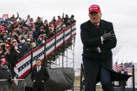 President Donald Trump jokes about the cold as he arrives for a campaign rally at Michigan Sports Stars Park, Sunday, Nov. 1, 2020, in Washington, Mich. (AP Photo/Evan Vucci)