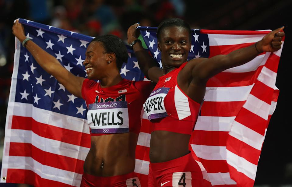 LONDON, ENGLAND - AUGUST 07: Bronze medalist Kellie Wells and silver medalist Dawn Harper of the United States celebrate after the Women's 100m Hurdles Final on Day 11 of the London 2012 Olympic Games at Olympic Stadium on August 7, 2012 in London, England. (Photo by Alexander Hassenstein/Getty Images)