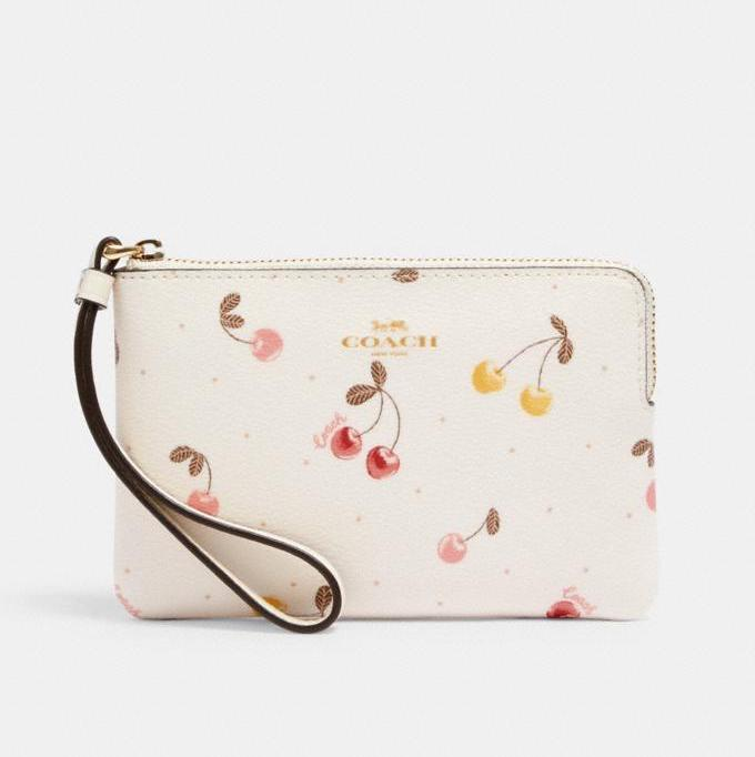 Corner Zip Wristlet With Painted Cherry Print. Image via Coach Outlet.