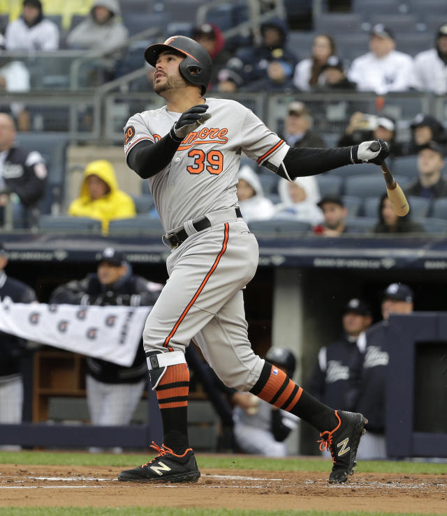 Baltimore Orioles' Renato Nunez watches his three-run home run during the first inning of a baseball game against the New York Yankees at Yankee Stadium, Sunday, March 31, 2019, in New York. (AP Photo/Seth Wenig)